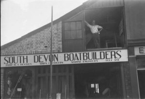 South Devon Boatbuilders premises with John Kelley(?) at the loft door